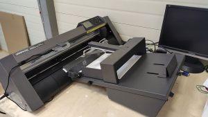 Плоттерная резка с автоматической подачей бумаги